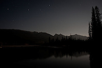 This is a long exposure shot taken in the dark of night, shortly after the full moon rose above the horizon...The Athabasca River as seen from the Wabasso campground in Jasper National Park.