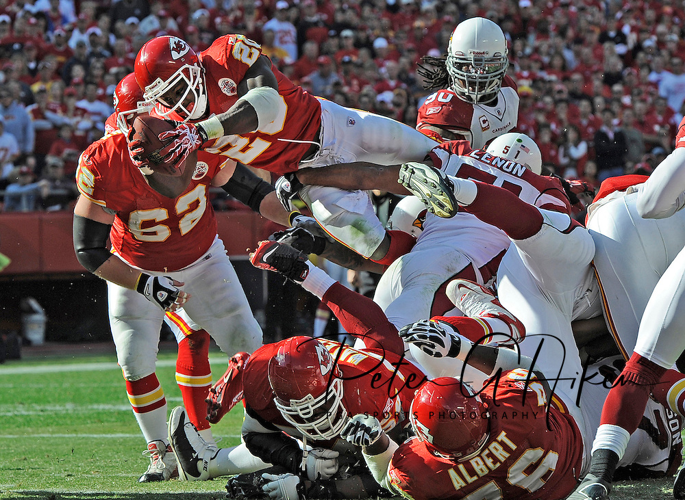 Running back Thomas Jones #20 of the Kansas City Chiefs dives over the goal line from one-yard out for a second quarter touchdown against the Arizona Cardinals at Arrowhead Stadium in Kansas City, Missouri.  ..