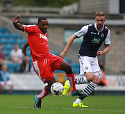 Chesterfield player Sylvan Ebanks-Blake shields the ball from Millwall player Mark Beevers during the Sky Bet League 1 match between Millwall and Chesterfield at The Den, London, England on 29 August 2015. Photo by Bennett Dean.