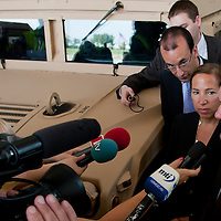 Eleni Tsakopoulos Kounalakis (2nd R) ambassador for the United States of America and Csaba Hende (R)Defence Minister for Hungary talk next to a Hummer during the presentation of the Coalition Support Fund for Hungary by the US military in Szolnok, Hungary on July 18, 2011. ATTILA VOLGYI