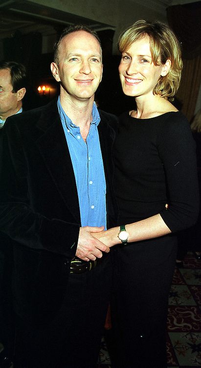 MR & MRS SIMON SEBAG-MONTEFIORE she was Santa Palmer-Tomkinson family friend of HRH The Prince of Wales, at a reception in London on 10th November 1999.MYZ 26