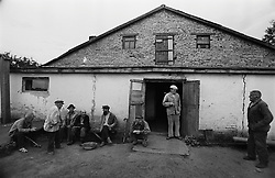 Residents of  house for an old released prisoners seat near their barrack where they live in village Blagoveshenka, Kemerovo region, Eastern Siberia, Russia, 16 August 1995. Blagoveshensky house for an old former prisoners a special institution which is a part of a penitentiary system where live former prisoners which have age more then 55 years after released and haven't house or an apartment and relatives.