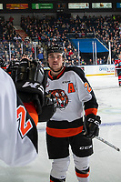 KELOWNA, BC - NOVEMBER 8: Bryan Lockner #23 of the Medicine Hat Tigers celebrates a goal with fist bumps along the bench against the Kelowna Rockets  at Prospera Place on November 8, 2019 in Kelowna, Canada. (Photo by Marissa Baecker/Shoot the Breeze)