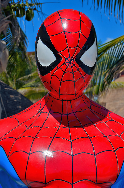 Spider-Man Statue Close Up at Riviera Maya, Mexico <br /> In August, 1962, artists Stan Lee and Steve Ditko introduced the world to teenager Peter Parker and his crime-fighting abilities as Spider-Man.  Since his debut in that &ldquo;Amazing Fantasy&rdquo; issue, this red-masked superhero has gone on to be super popular in films, a TV series, comic books and newspaper funny pages. He is the commercial delight of Marvel Comics, children and adults who want to cling on to their youth. This statue was at a resort along the Riviera Maya, Mexico. It was part of a program for kids.