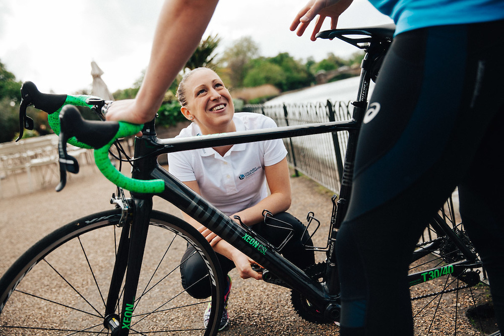British professional triathlete Jodie Stimpson teaches journalist, Oliver Pickup, cycling techniques. 6th May 2015, London. Photographed by Greg Funnell for the Financial Times.