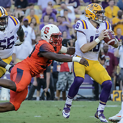 Sep 23, 2017; Baton Rouge, LA, USA; LSU Tigers quarterback Danny Etling (16) is sacked by Syracuse Orange defensive lineman Kendall Coleman (55) during the first quarter of a game at Tiger Stadium. Mandatory Credit: Derick E. Hingle-USA TODAY Sports