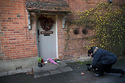 © Licensed to London News Pictures. 26/12/2016. Goring-, UK. A TV camera woman films floral tributes left at the door of George Michael's Oxfordshire home. Pop superstar George Michael died on Christmas day at his Oxfordshire home on the River Thames aged 53. Photo credit: Peter Macdiarmid/LNP