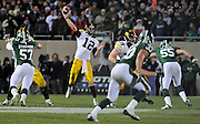 Oct 24, 2009; East Lansing, MI, USA; Iowa quarterback Ricky Stanzi (12) during the fourth quarter against Michigan State Spartans at Spartan Stadium. The Hawkeyes beat the Spartans 15-13. Mandatory Credit: Jason Miller-US PRESSWIRE