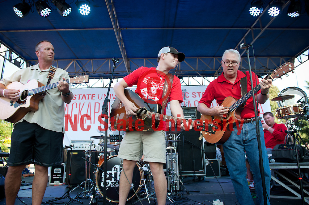 Scotty McCreery, center, Chancellor Woodson, right, and Football coach Dave Doeren perform at Packapalooza.