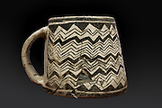 Mug and pot lid with black on white geometric painted design, 1180-1280 AD, from Mesa Verde, Pueblo III period, (mug or ceramic lids were rarely produced outside of the Northen San Juan region), from The Anasazi Heritage Centre, Dolores, Colorado, USA. Picture by Manuel Cohen