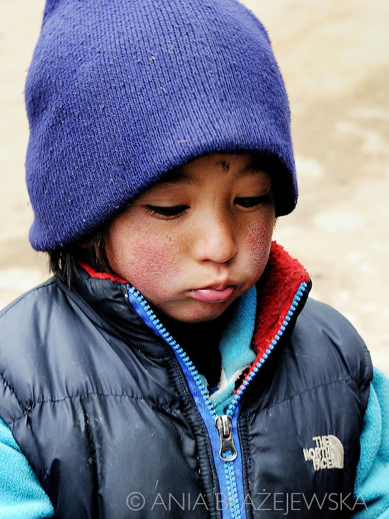 Nepal, Himalayas. Portrait of a sad Sherpa girl.