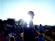 Crowd of young people at a music festival.