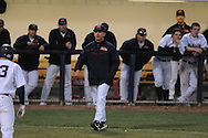 Ole Miss Head Coach Mike Bianco (5) talks to the home plate umpire vs. Jackson State at Oxford-University Stadium in Oxford, Miss. on Tuesday, March 15, 2011.