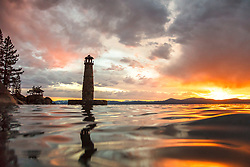 """""""Thunderbird Lighthouse at Sunset 1"""" - Photograph of the Thunderbird Lighthouse on the east shore of Lake Tahoe. Shot at sunset from a kayak with the camera in an underwater housing and the lens right on the surface of the water."""