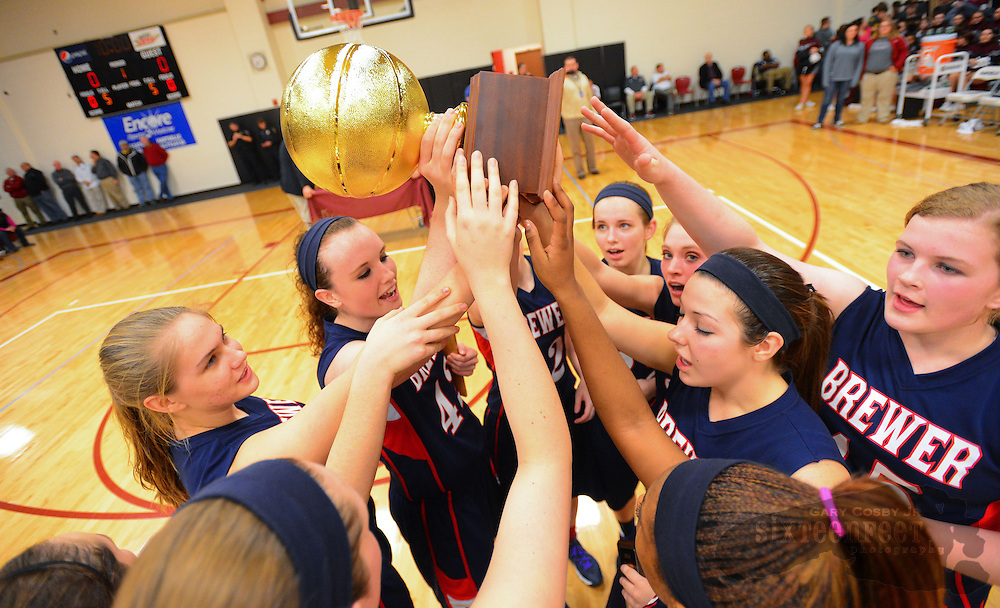 Gary Cosby Jr./Decatur Daily   The Brewer High girls team claims the trophy after defeating Hartselle to win  the Morgan County Tournament Saturday night in Hartselle.