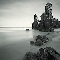 High rocks on a peaceful beach