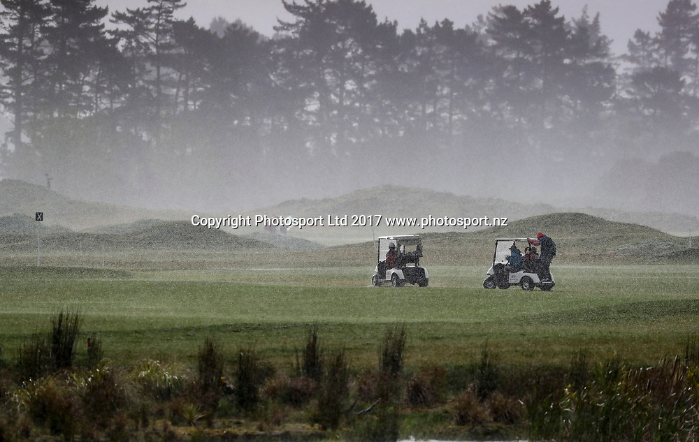 Fans and players make their way off the course after play was abandoned due to weather. Final Round , McKayson NZ Women's Open 2017. LPGA Tour. Windross Farm, Auckland, New Zealand. Sunday 01 October, 2017. Copyright photo: John Cowpland / www.photosport.nz