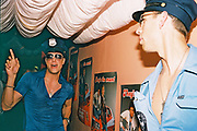 Two men wearing US police style caps at Carwash 10th birthday party at The Aquarium, London, UK, 10th July 2004