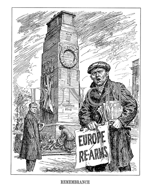 Remembrance - Europe Re-Arms (a street newspaper seller with the latest headline amid the Remembrance Day for The Glorious Dead of WW1)