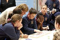 """03 FEB 2004, BERLIN/GERMANY:<br /> Angela Merkel, CDU Bundesvorsitzende, mit Kindern, die am Workshop für Kids """"Elektrizitaet-Magnetismus-Bewegung"""" teilnehmen, Auftaktkongress zum IHK-Jahresthema """"Innovation UNternehmen!"""", Deutscher Industrie- und Handelskammertag, DIHK, Haus der Deutschen Wirtschaft <br /> IMAGE: 20040203-01-041<br /> KEYWORDS: Innovationskongress"""