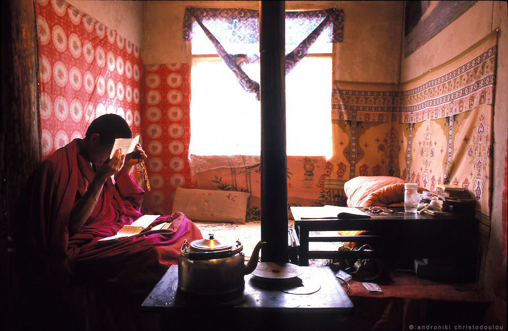 Most of the monks study Buddhaís words, meditate and pray in their small houses. Oulsal shares his one room house with one more monk..LAMBRANG MONASTERY IN XIAHE - CHINA.copyright: Androniki Christodoulou.