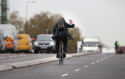 © Licensed to London News Pictures. 19/11/2015. London, UK.   London Mayor Boris Johnson tries out the newly opened Cycle Superhighway 5  on Vauxhall Bridge. Dedicated cycle lanes are being installed throughout the capital.  Photo credit: Peter Macdiarmid/LNP