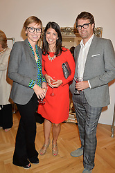 Left to right, JO ELVIN, GINA COLADANGELO and her husband OLIVER TRESS founder of the Oliver Bonas stores at a party to celebrate the opening of the first Tabitha Webb Retail Store at 45 Elizabeth Street, London on 23rd September 2014.