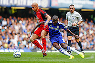 Ramires of Chelsea (right) battles with Jonjo Shelvey of Swansea City during the Barclays Premier League match at Stamford Bridge, London<br /> Picture by David Horn/Focus Images Ltd +44 7545 970036<br /> 13/09/2014