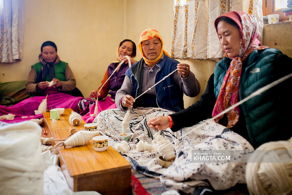 Women of Spiti, making thread for leisure from the warm goat wool. They gather in different houses and work together during the cold winter months.