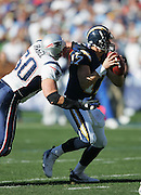 SAN DIEGO - JANUARY 14:  Linebacker Mike Vrabel #50 of the New England Patriots sacks quarterback Philip Rivers #17 of the San Diego Chargers at the AFC Divisional Playoff Game held on January 14, 2007 at Qualcomm Stadium in San Diego, California. The Patriots defeated the Chargers 24-21. ©Paul Anthony Spinelli *** Local Caption *** Mike Vrabel;Philip Rivers
