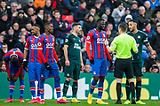 Peter Bankes (Referee) diffusing a situation with the players during the Premier League match between Crystal Palace and Newcastle United at Selhurst Park, London, England on 22 February 2020.