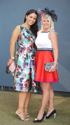 LIVERPOOL, ENGLAND - Thursday, April 9, 2015: Jannie Hancock, [L] 36, from Liverpool wearing a dress from Chi Chi and Paula Bruce, 35, from Liverpool wearing a dress from River Island and shoes from New Look during Grand Opening Day on Day One of the Aintree Grand National Festival at Aintree Racecourse. (Pic by David Rawcliffe/Propaganda)