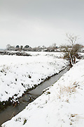 Vertical format of Durleigh Brook after snow, looking towards Durleigh.