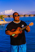 Polynesian man playing a ukelele, Four Seasons Resort Bora Bora, Motu Tehotu, Bora Bora, French Polynesia.