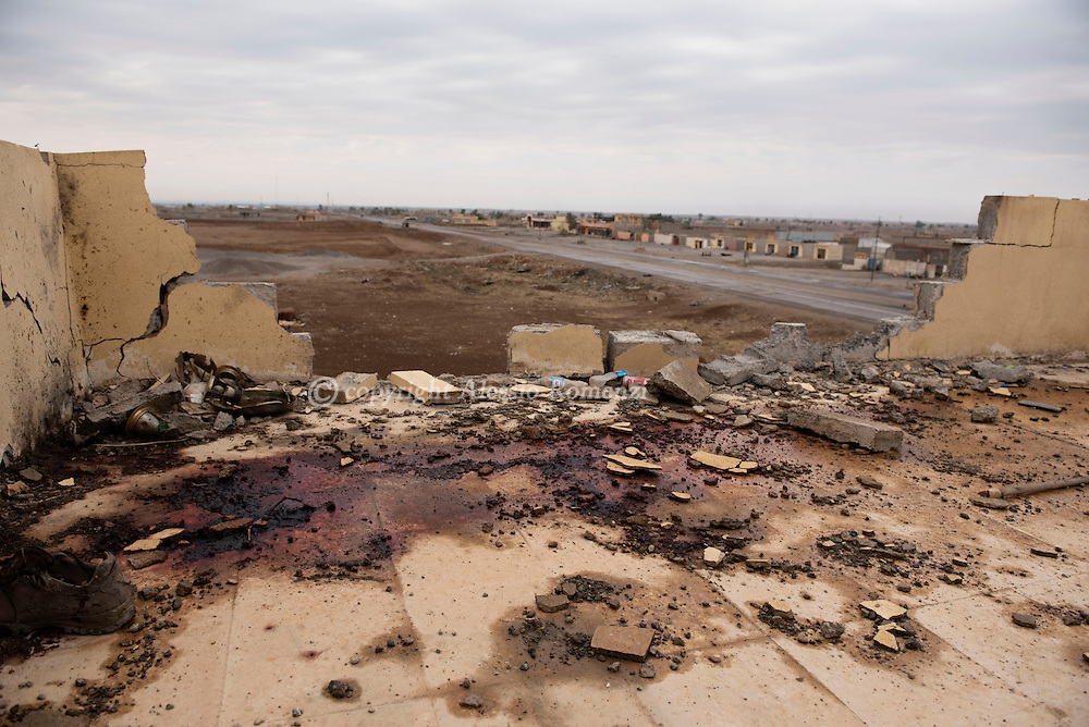 Iraq, Bazwaia: Blood stains are seen on a rooftop where ISIS fighter were positioned. Alessio Romenzi