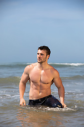 sexy muscular man in the ocean