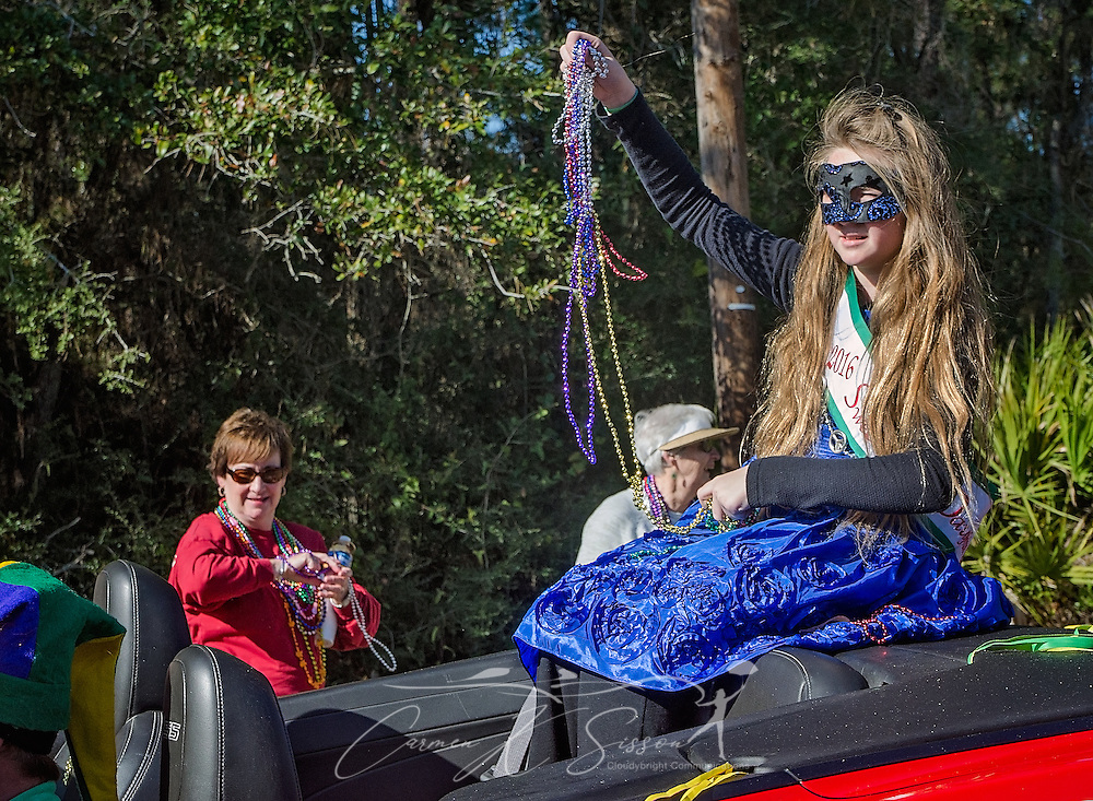 Grace Eyermann, 2016 Sweet Miss Dauphin Island, throws beads as she rides in Dauphin Island's first People's Parade during Mardi Gras, Feb. 4, 2017, in Dauphin Island, Alabama. French settlers held the first Mardi Gras in 1703, making Mobile's celebration the oldest Mardi Gras in the United States. The first parade of the season is traditionally held on Dauphin Island and draws thousands. (Photo by Carmen K. Sisson/Cloudybright)