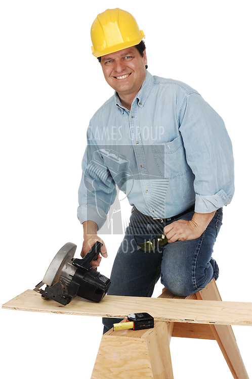 medium shot of a carpenter wearing a hard hat and demins about to cut a plank with a power saw. Shot on white background