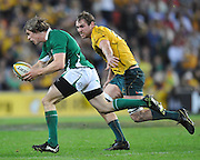 Andrew Trimble makes a break for the line with Rocky Elsom in hot pursuit during action from the Rugby Union Test Match played between Australia and Ireland at Suncorp Stadium (Brisbane) on Saturday 26th June 2010 ~ Australia (22) defeated Ireland (15) ~ © Image Aura Images.com.au ~ Conditions of Use: This image is intended for Editorial use as news and commentry in print, electronic and online media ~ Required Image Credit : Steven Hight (AURA Images)For any alternative use please contact AURA Images