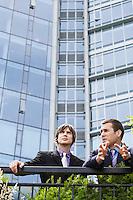 Two business men talking outside office