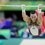 Gymnastics - Olympics: Day 1  Jacob Dalton #193 of the Unites States in action on the Horizontal Bar during the Men Qualification round in the Artistic Gymnastics competition at the Rio Olympic Arena on August 6, 2016 in Rio de Janeiro, Brazil. (Photo by Tim Clayton/Corbis via Getty Images)