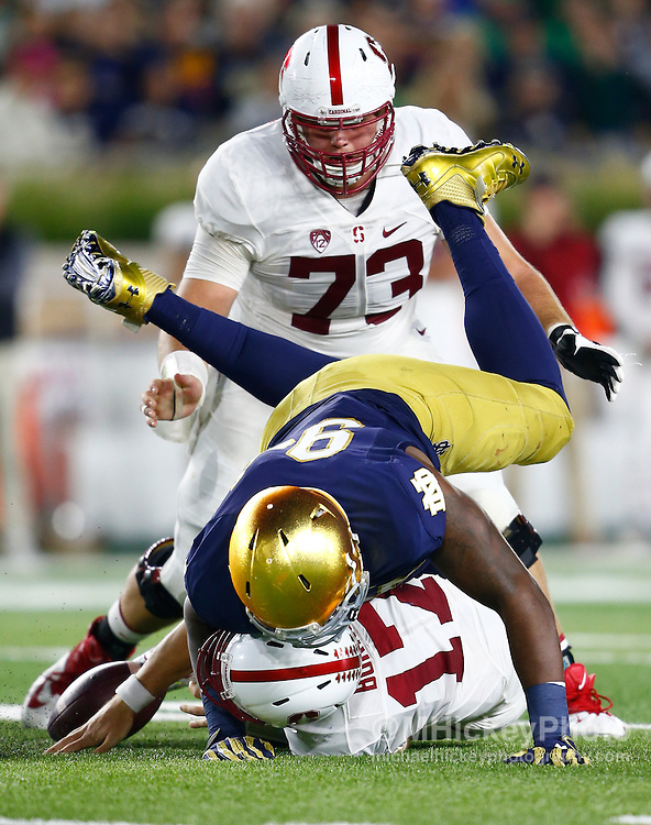 SOUTH BEND, IN - OCTOBER 15: Jarron Jones #94 of the Notre Dame Fighting Irish sacks Ryan Burns #17 of the Stanford Cardinal causing a fumble during the game at Notre Dame Stadium on October 15, 2016 in South Bend, Indiana. Stanford defeated Notre Dame 17-10. (Photo by Michael Hickey/Getty Images) *** Local Caption *** Jarron Jones; Ryan Burns