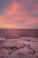 Dramatic sunrise at Peggy's Cove  heralds in approaching storm,  Nova Scotia