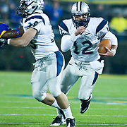 New Hampshire QB (#12) R.J. Toman RUSHES for 17 yards to the DELAWARE 35, 1ST DOWN UNH.  No. 5 Delaware defeats No.11 New Hampshire 16-3 on a brisk Friday night at Delaware stadium in Newark Delaware...Delaware will host the Division I FCS Championship Semifinals Round next weekend.