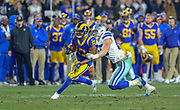 Jan 12, 2019; Los Angeles, CA, USA;  Los Angeles Rams wide receiver Robert Woods (17) attempts to break free from a tackle from Dallas Cowboys linebacker Leighton Vander Esch (55) during an NFL divisional playoff game at the Los Angeles Coliseum. The Rams beat the Cowboys 30-22. (Kim Hukari/Image of Sport)