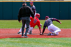 NORMAL, IL - April 08: Derek Parola slides in safely under a tag attempt by Mason Hull and called by Phil Pupillo during a college baseball game between the ISU Redbirds  and the Missouri State Bears on April 08 2019 at Duffy Bass Field in Normal, IL. (Photo by Alan Look)