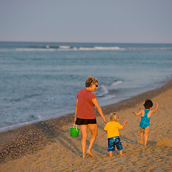 A woman and her young kids play at the beach at the Cape Cod National Seashore in Truro, Massachusetts.  Head of the Meadow Beach.
