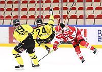 2019-12-08 | Ljungby, Sweden: Vimmerby HC (24) Roman Semjonov and Troja-Ljungby (19) Victor Romfors during the game between IF Troja / Ljungby and Vimmerby HC at Ljungby Arena ( Photo by: Fredrik Sten | Swe Press Photo )<br /> <br /> Keywords: Ljungby, Icehockey, HockeyEttan, Ljungby Arena, IF Troja / Ljungby, Vimmerby HC, fstv191208, ATG HockeyEttan