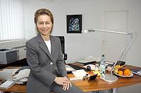 12 DEC 2005, BERLIN/GERMANY:<br /> Ursula von der Leyen, CDU, Bundesfamilienministerin, in ihrem Buero, Bundesministerium fuer Familie, Senioren, Frauen, und Jugend<br /> Ursula von der Leyen, Federal Minister for family, Seniors, Women and Youth, in her office<br /> IMAGE: 20051212-01-0<br /> KEYWORDS: Büro, Schreibtisch