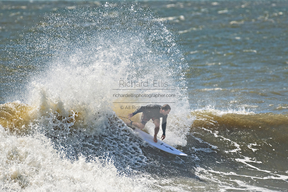Folly Beach, South Carolina, USA. 03 September 2019. A surfer rides a large wave caused by the approaching Hurricane Dorian September 3, 2019 in Folly Beach, South Carolina. The slow moving monster storm devastated the Bahamas and is expected to reach Charleston as a Category 2 by Thursday morning.